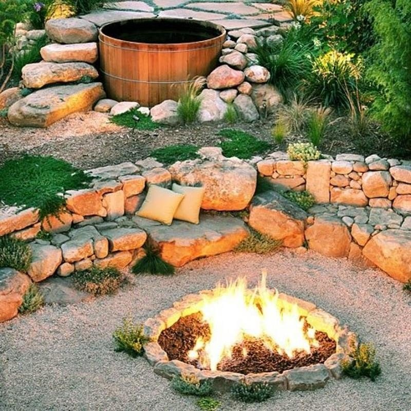 The cheapest idea - a gravel patio with boulders as seating around a fire pit