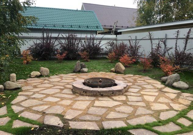 Patio design idea with circular fire pit