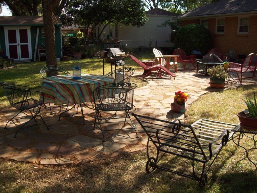 A flagstone patio idea with dining area and fire pit