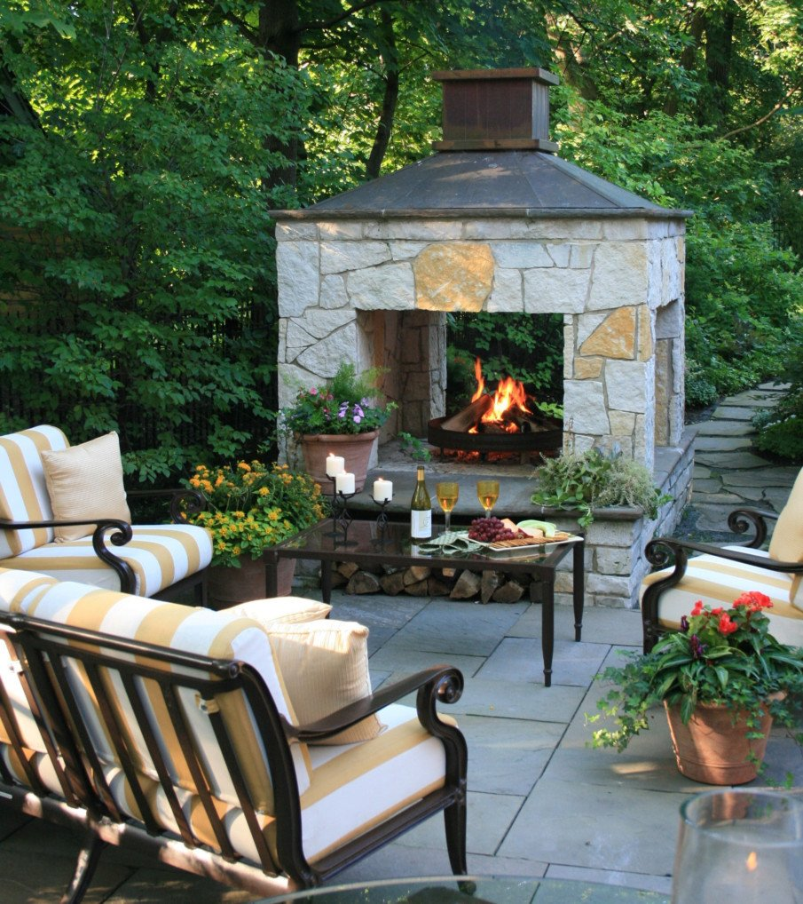 Four sided outdoor fireplace design for large spaces