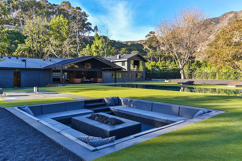 Fully sunken concrete patio with firepit and built in seating