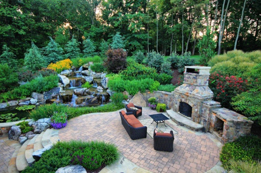 Gorgeous outdoor space design with fireplace and waterfall