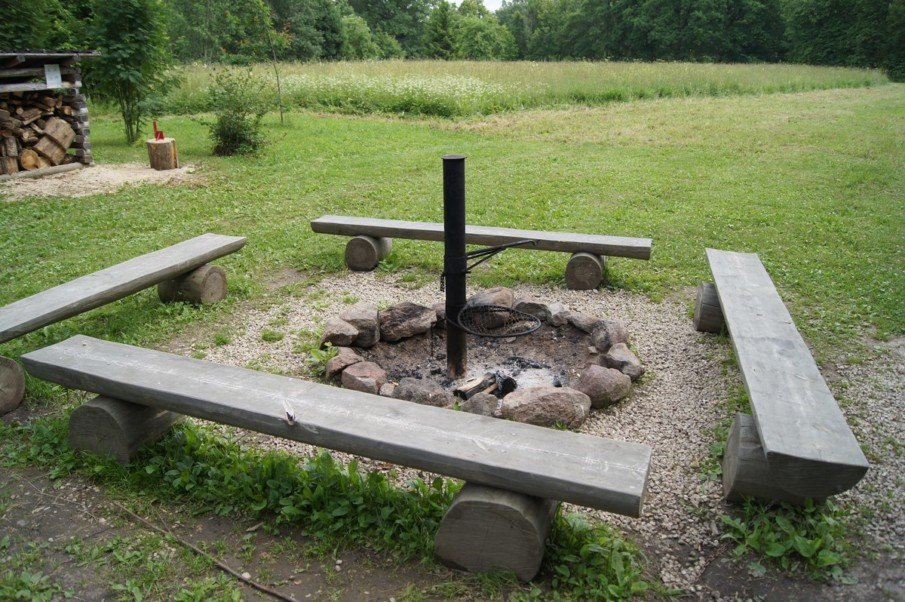 On a budget fire pit setting idea - old logs and loose stones picked around the backyard