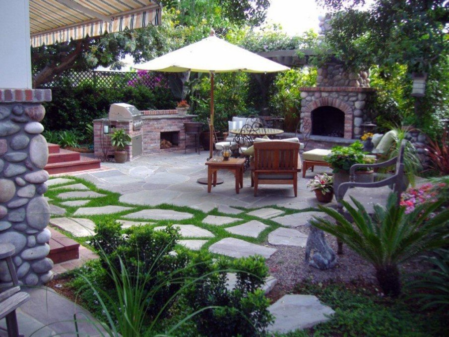 Hardscape patio design with flagstones and fireplace