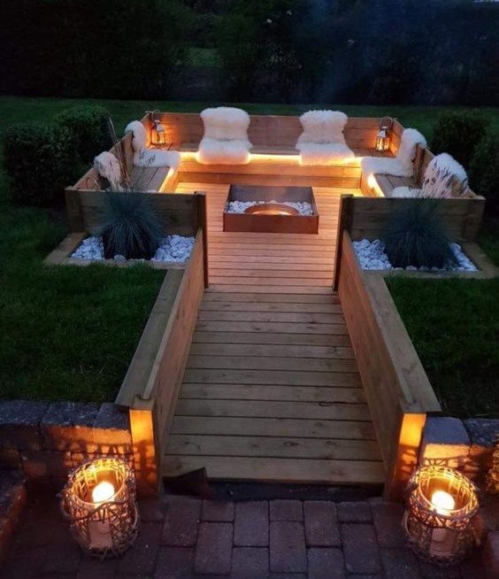 Improvised sunken fire pit area built entirely from wood