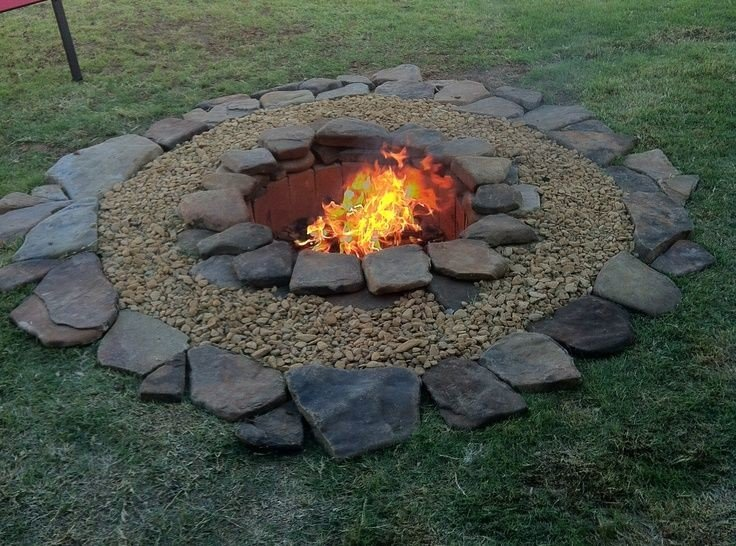 In ground flagstone fire pit idea