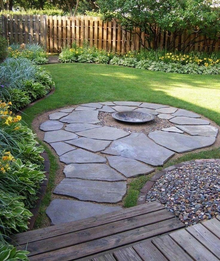 An inexpensive small flagstone patio idea with metal fire pit