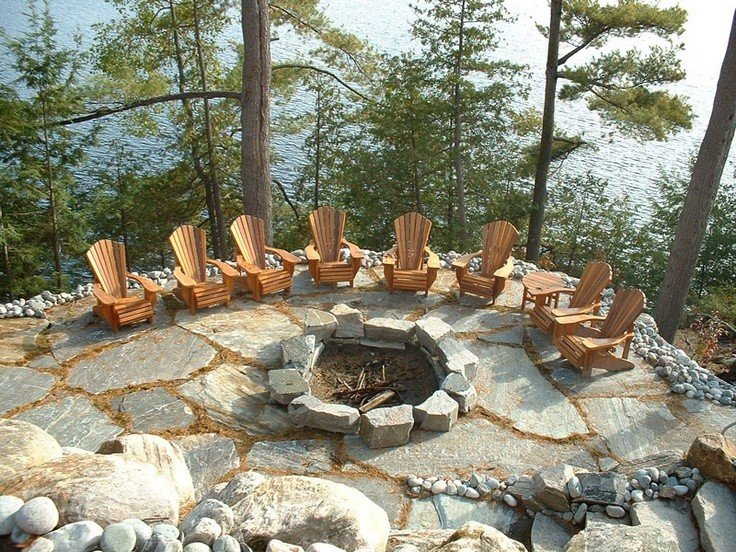 Large flagstone clad patio design for campfire setting
