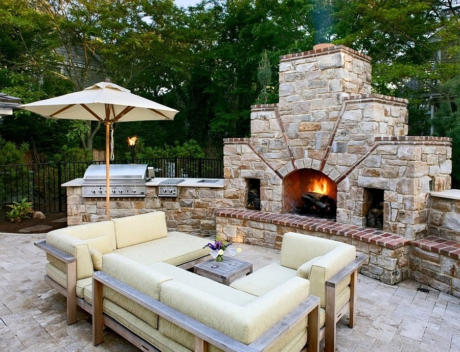 Large stone outdoor fireplace with shelf - an unusual idea