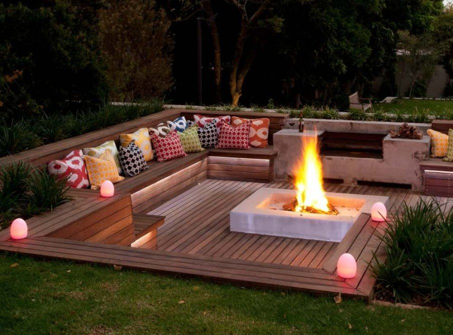 Large wood sunken patio with fire pit idea