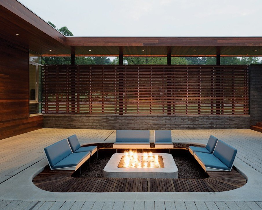 Modern patio with sunken seating area and biofuel fireplace