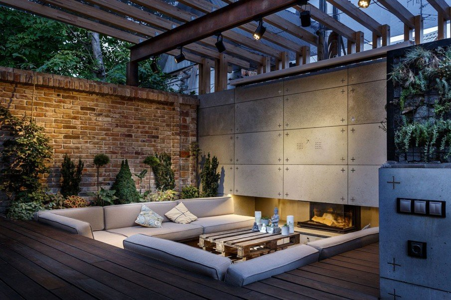 Modern sunken patio with built in fire place