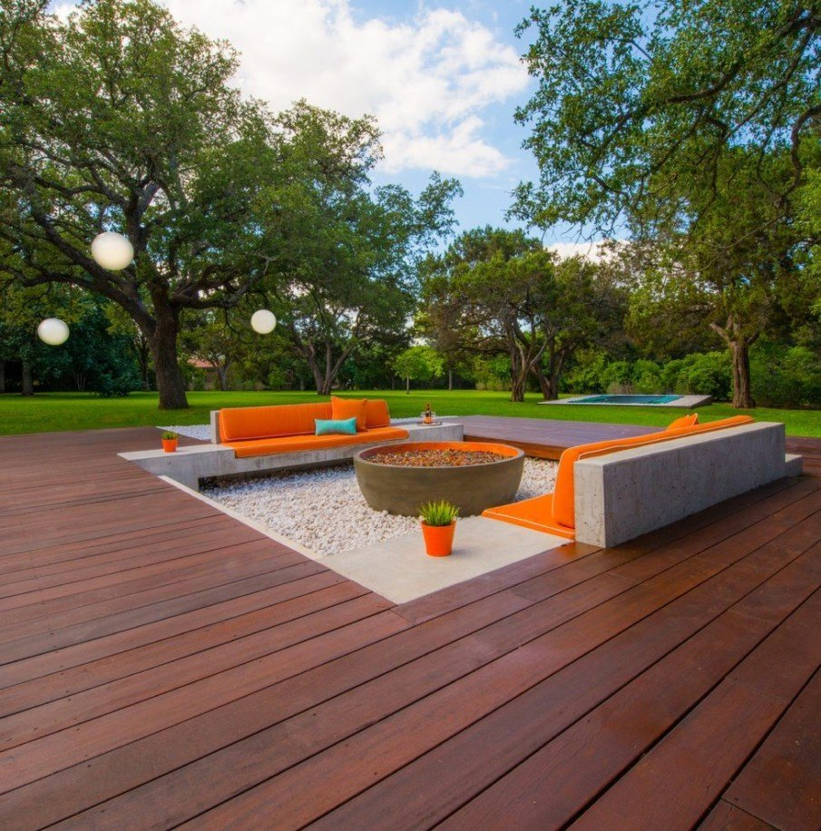 Modern wooden patio with sunken fire pit area
