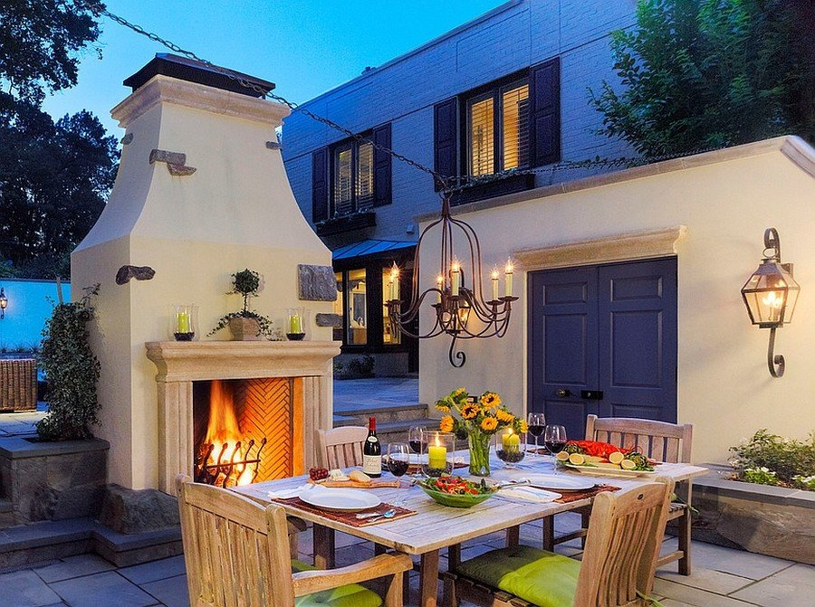 Outdoor dining space with a fireplace