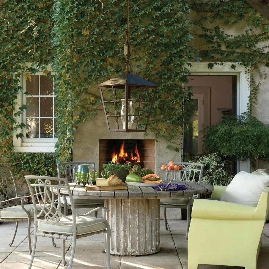 traditional outdoor fireplace built into house
