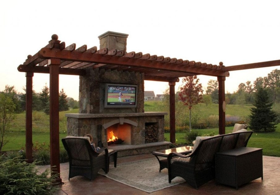Outdoor fireplace with wooden pergola