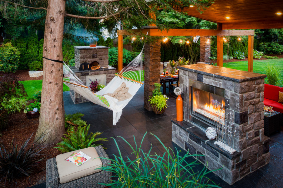 Outdoor living space with hammock and fireplace
