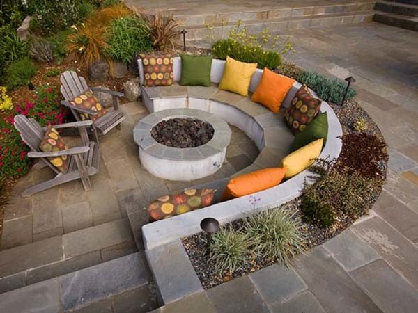 Partially sunken patio with firepit and cozy seating