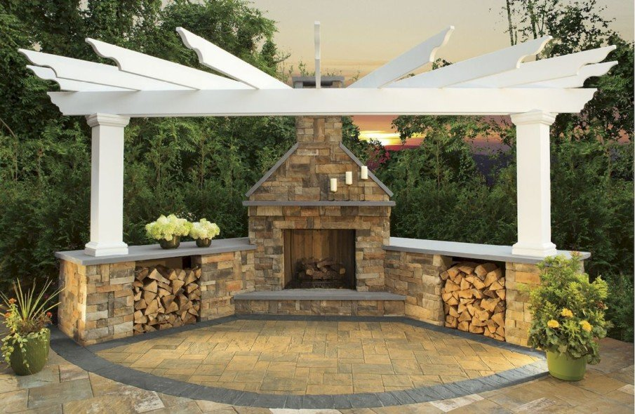 Patio design with decorative pergola and fireplace