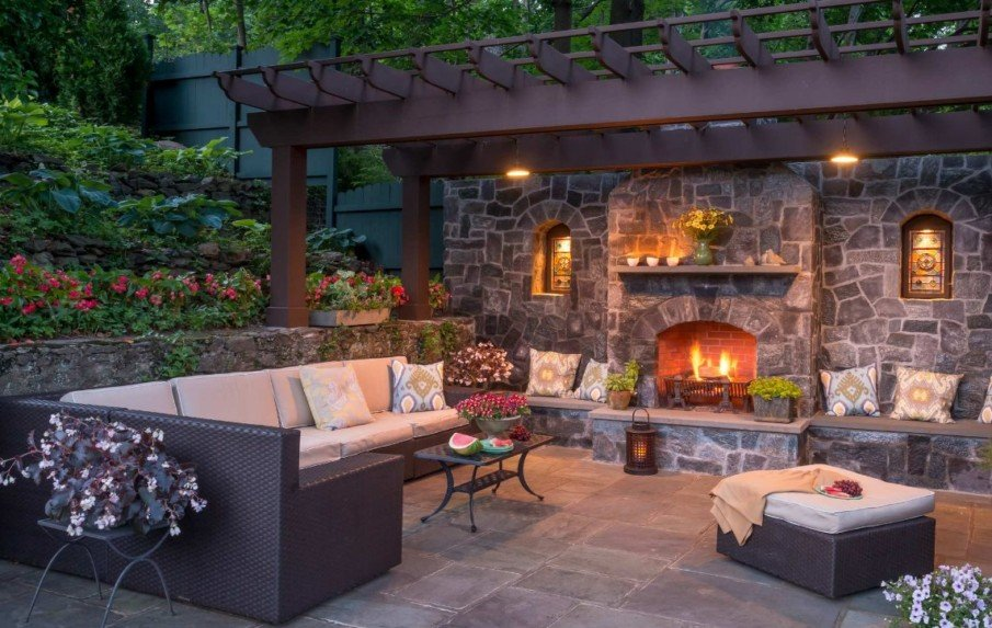 Patio design with pergola and built-in fireplace
