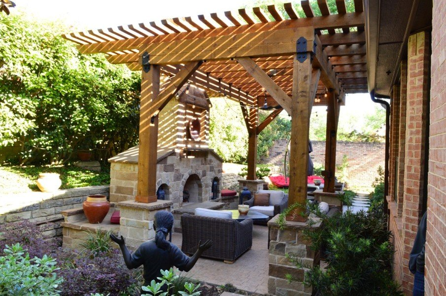 Patio design with simple pergola and fireplace