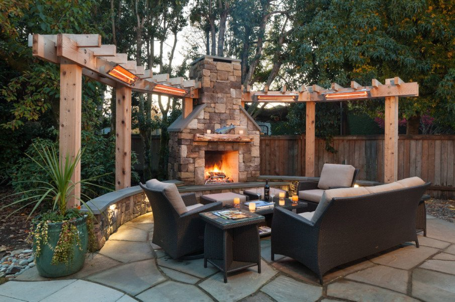 Patio designs with circular pergola and fireplace and wall heaters