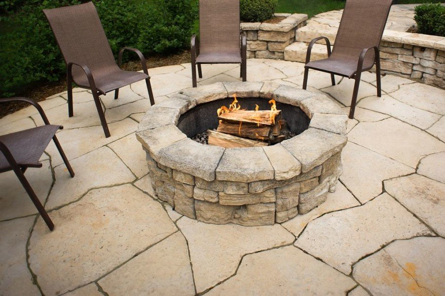 A patio fire pit made from flagstones