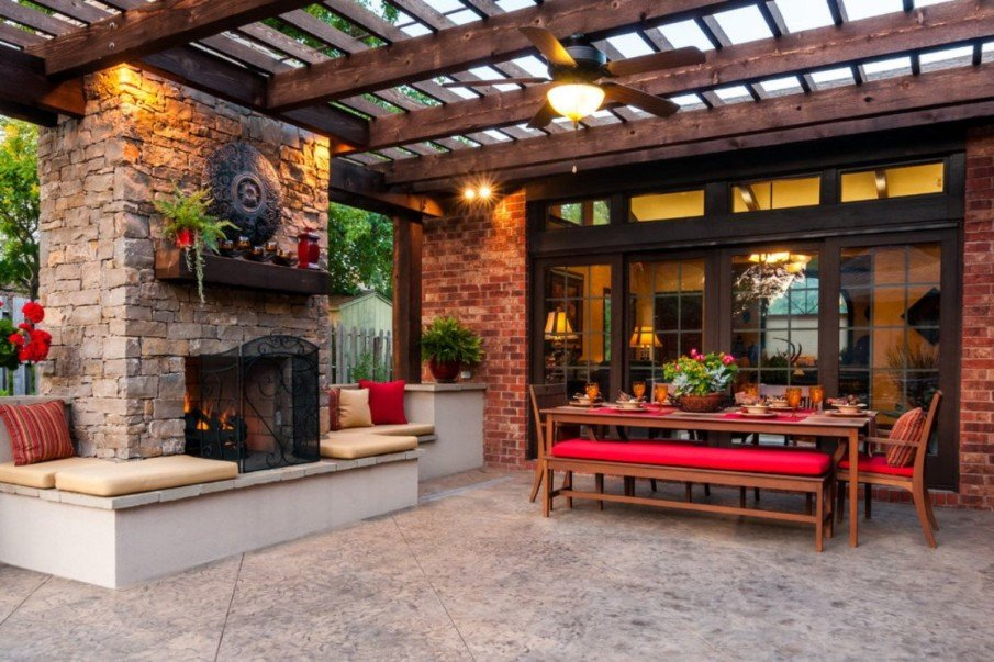 Patio with fireplace and wooden pergola ideas
