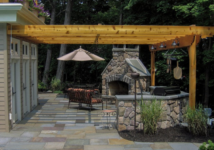 Awesome patio with a pergola attached to the house on one side