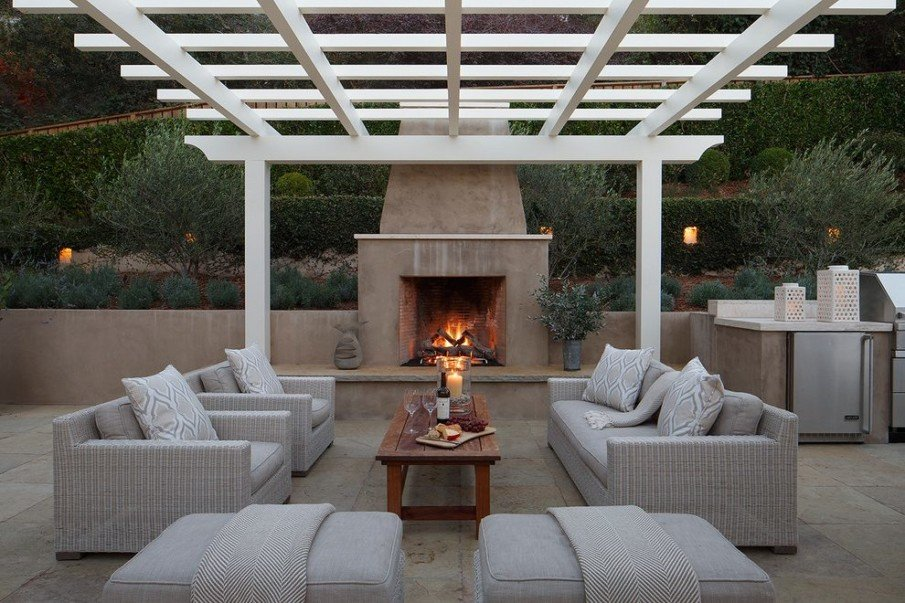 Patio with a nice vinyl pergola and fireplace
