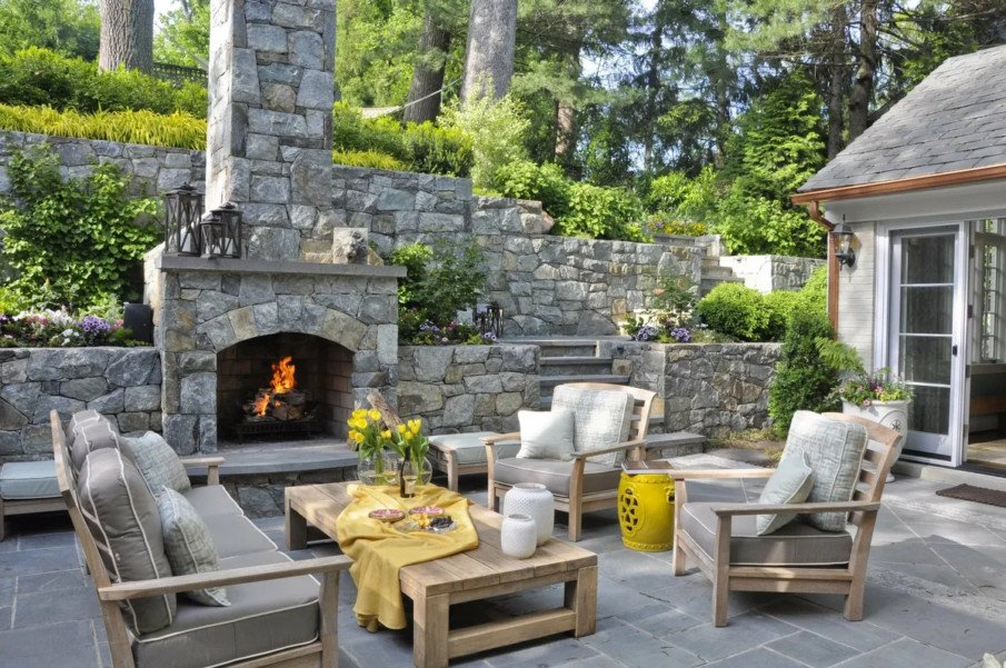 Stone fireplace in a semi screened patio