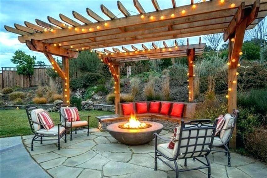 Patio with two pergolas and fireplace