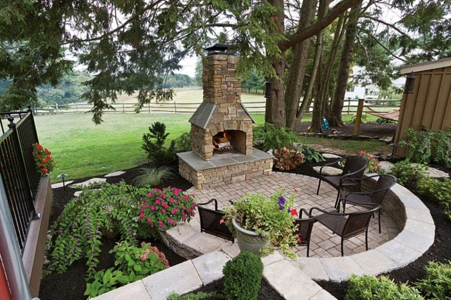 Precast fireplace idea for a circular patio