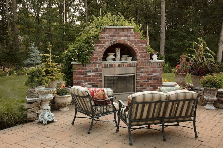 Red brick outdoor fireplace in a beautiful patio