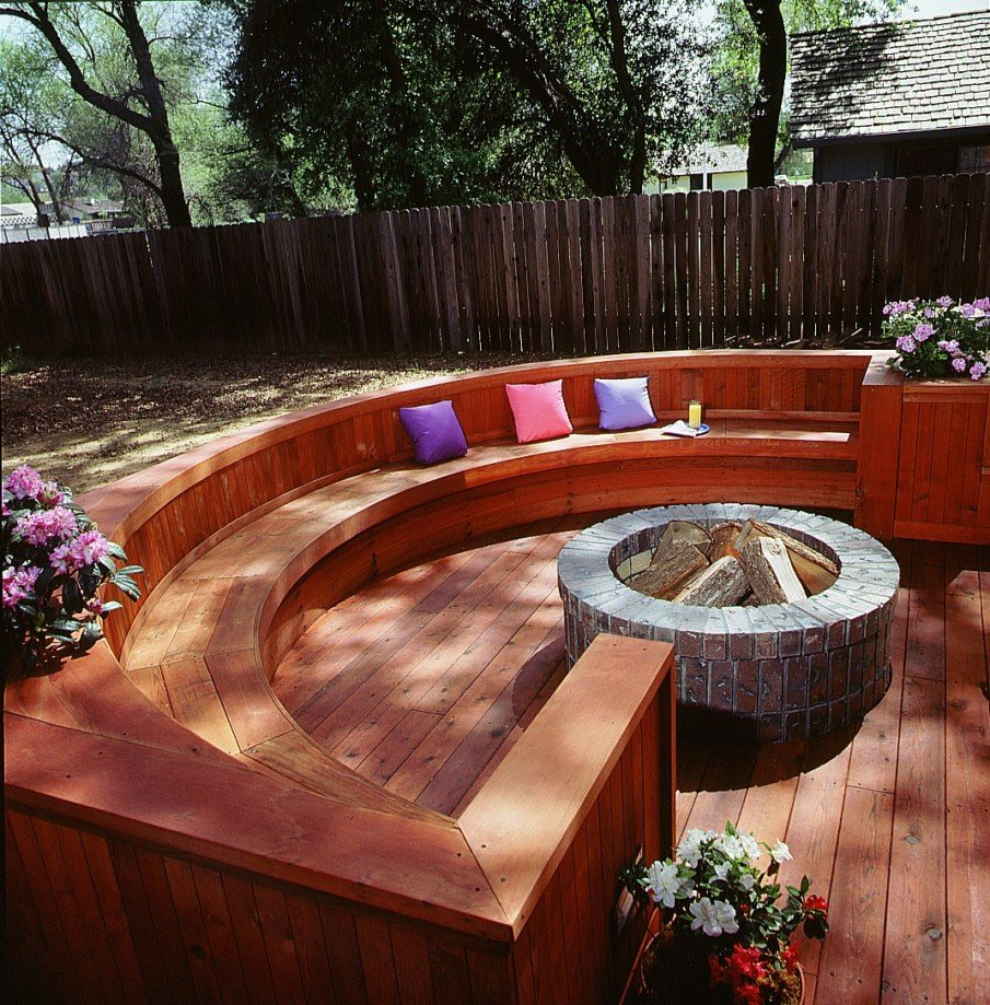 Redwood deck circular fire pit seating idea