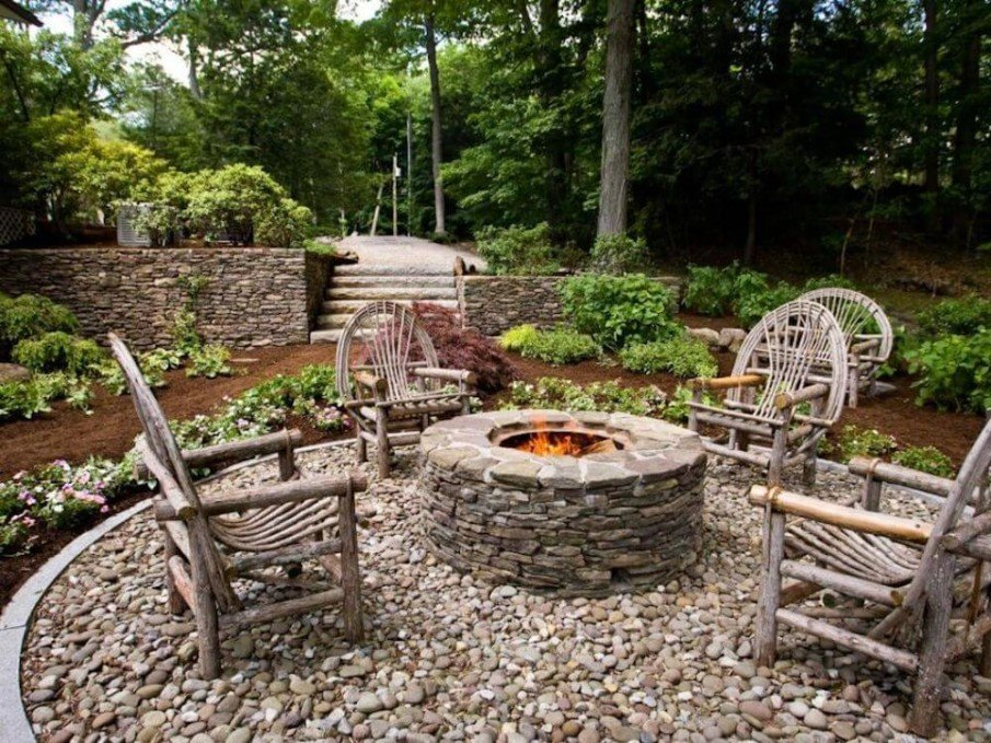 River rock patio with rustic fire pit design