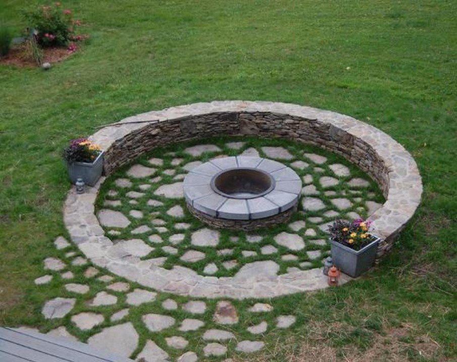 Rustic round patio with circular fire pit seating