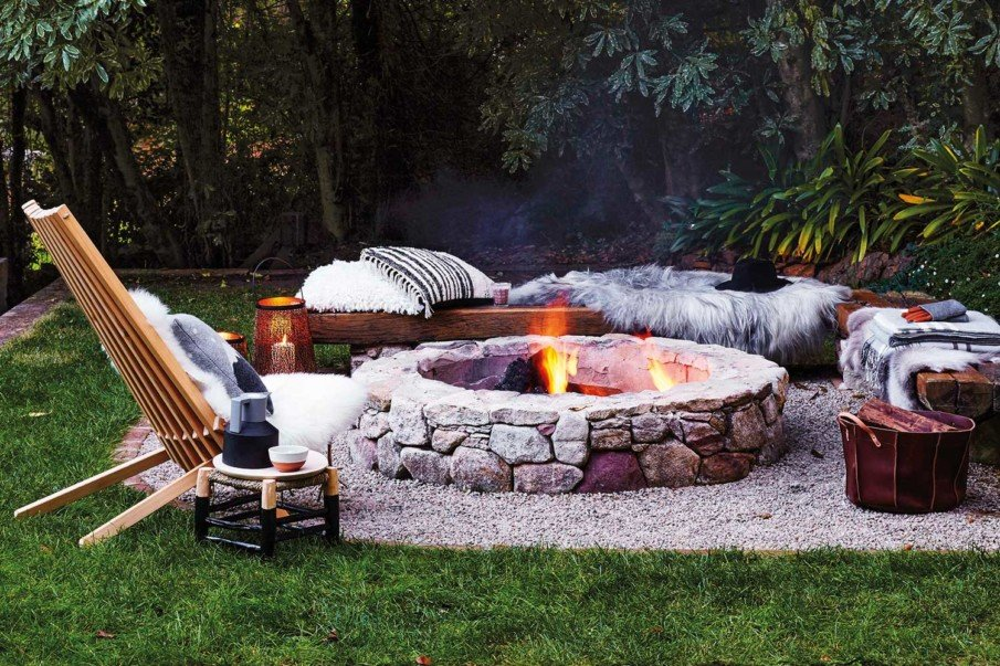 Scandinavian style stone and gravel fireplace with wooden benches
