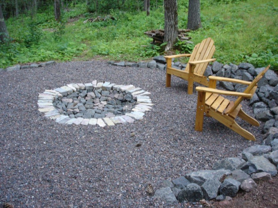 A very simple backyard fire pit idea with wooden chairs