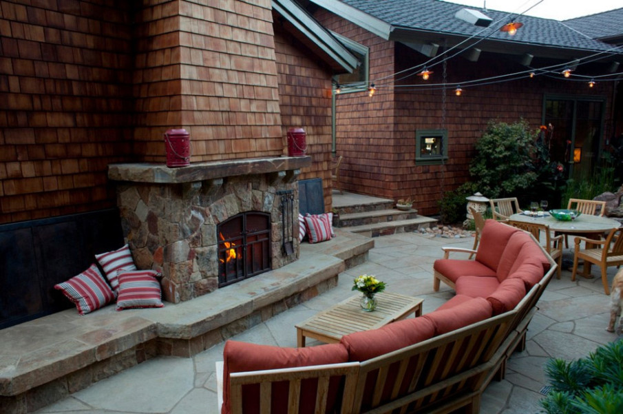 Simple cozy patio design with built-in fire place