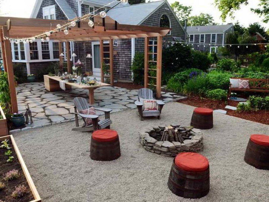 Simple stone fire pit with barrel stools seating