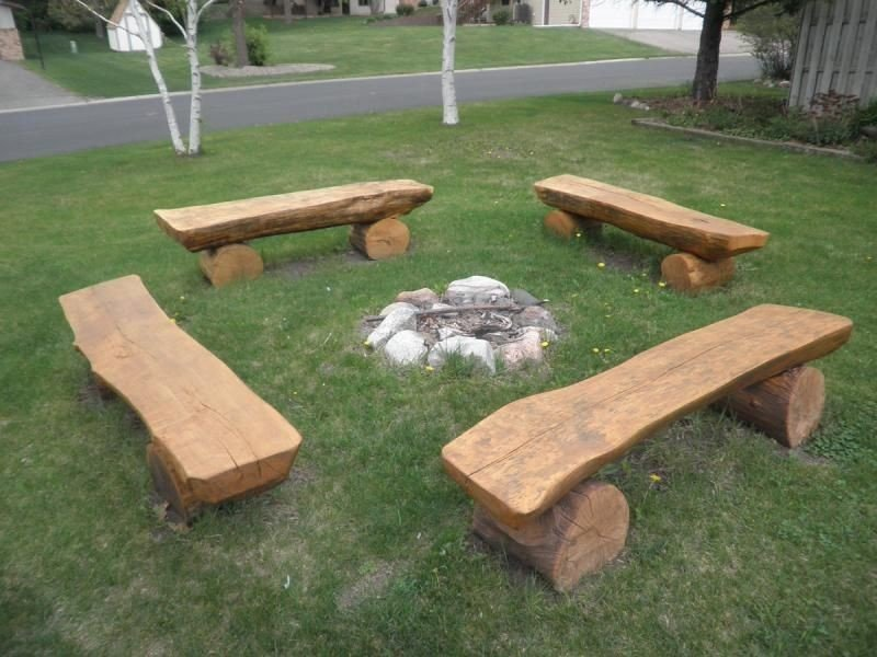 Simply place half log benches on a grass around a fire pit