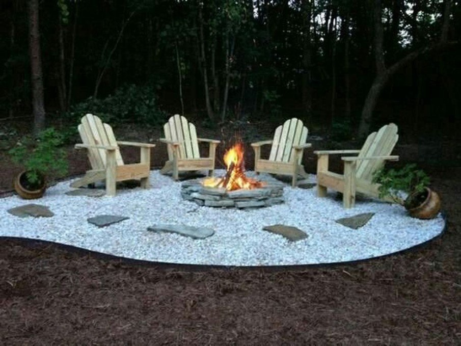 River rock patio is the least expensive idea for a fire pit setting