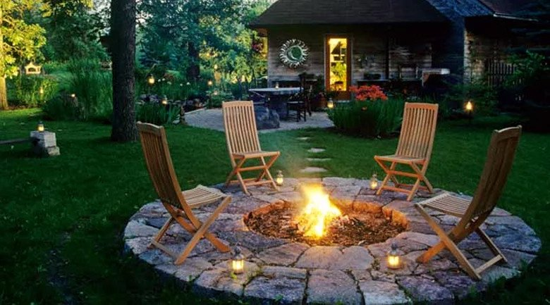 Stylish wooden chairs around a simple sunken fire pit