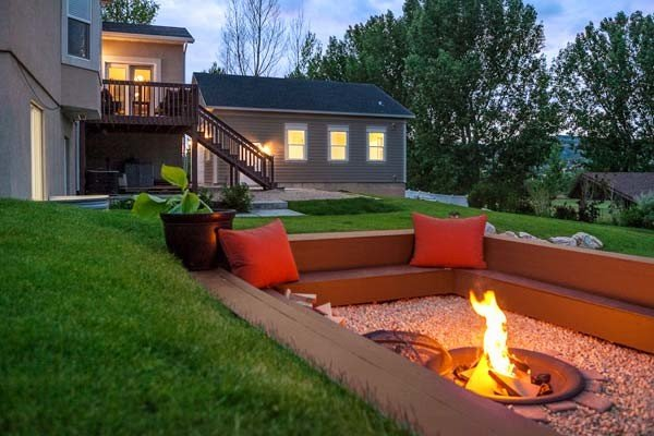 Simple sunken patio fire pit seating area made with wood beams