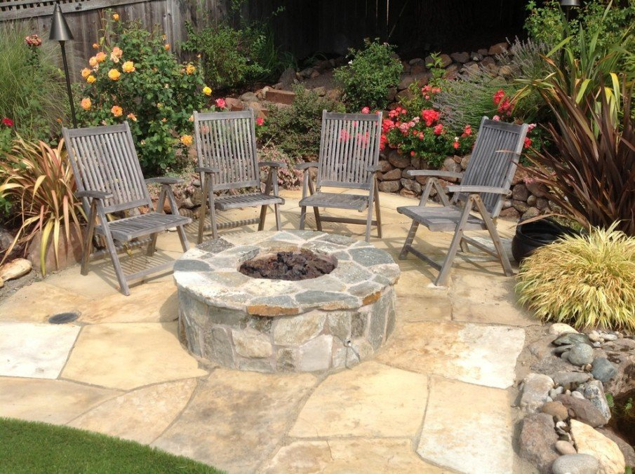 small patio design with flagstone built in fire pit
