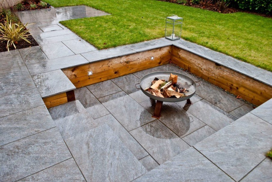 Small square sunken patio with metal fire pit