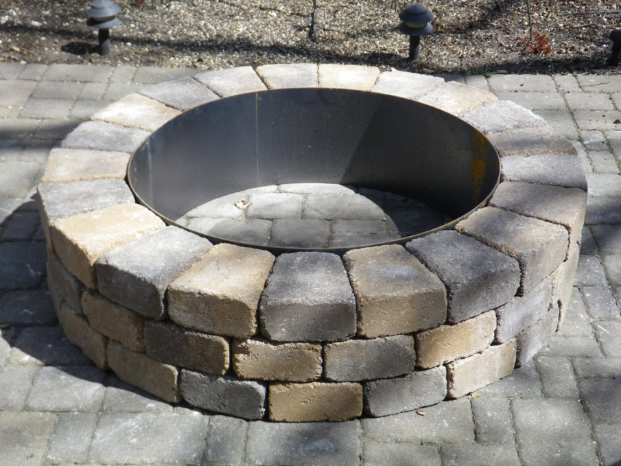 Stacked pavers fire pit with metal ring inserts