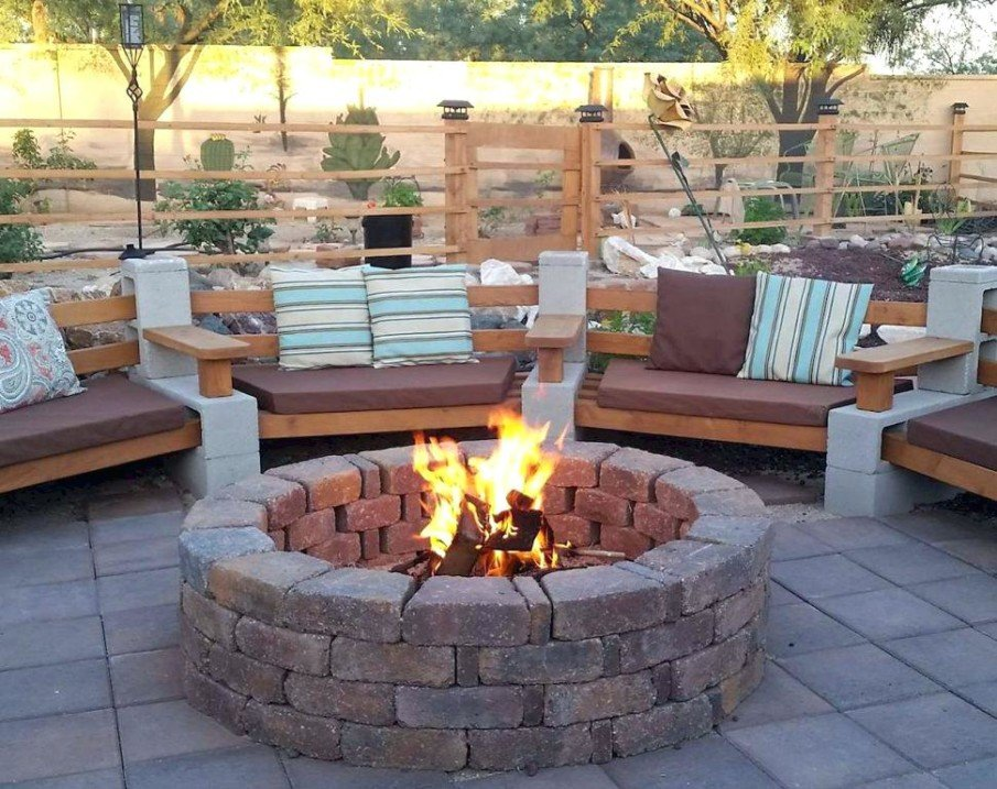 Stacked stone fire pit with circular seating idea
