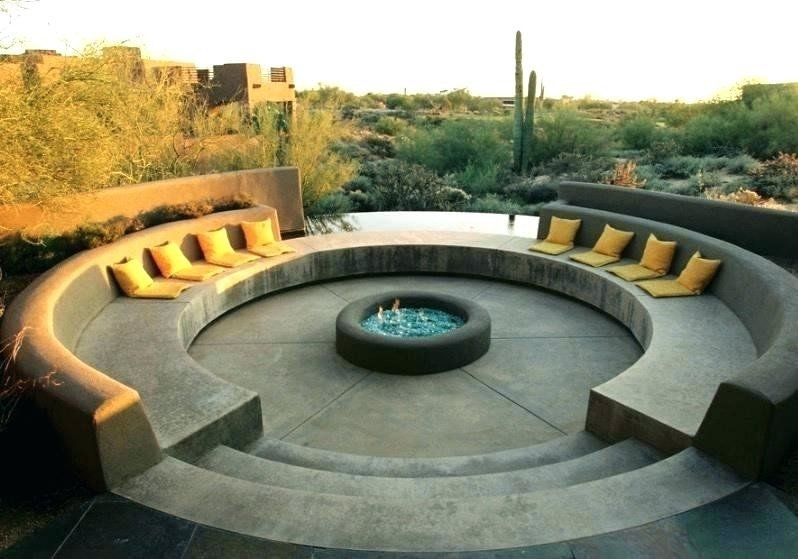 Stunning concrete sunken fire pit seating with circular design